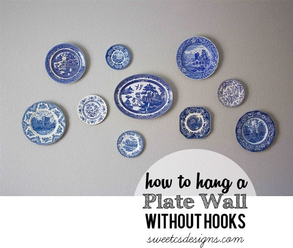How to hang a plate wall without hooks at sweetcsdesigns.com- this is such a great tip! No more hooks showing from plates and you can move plates around easily! #homedecor #plates #diy