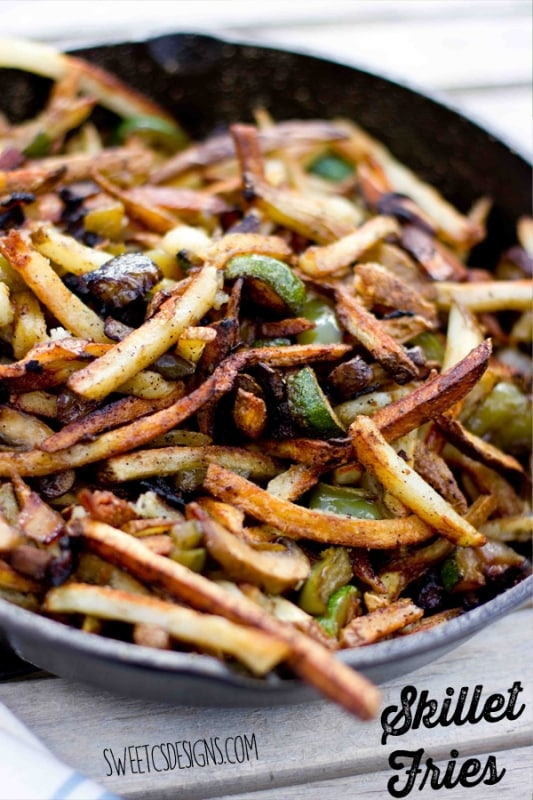 The perfect side dish for any cookout or camping Skillet Fries! These are so easy and delicious- and pack in a ton of veggies, too! Find it at sweetcsdesigns.com #fries #skillet