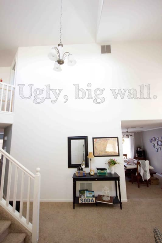 make an akward, big entry facing wall look better with family photos!
