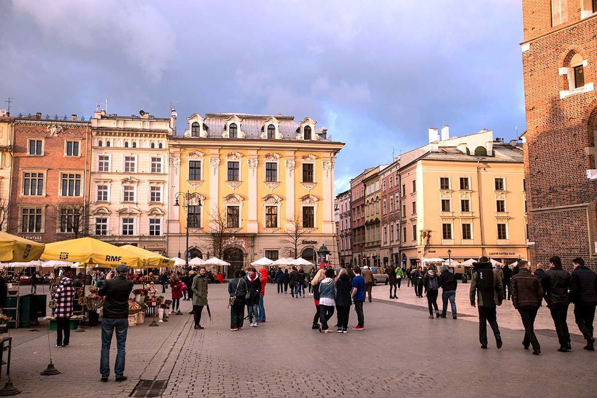 Krakow main square at sunset- love all the flower vendors and cafes!