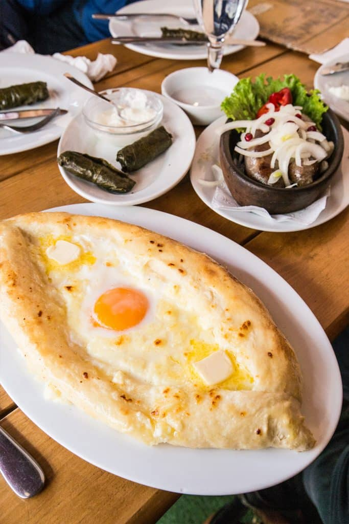 Khachapuri, sausages and dolmades at a Tbilisi cafe