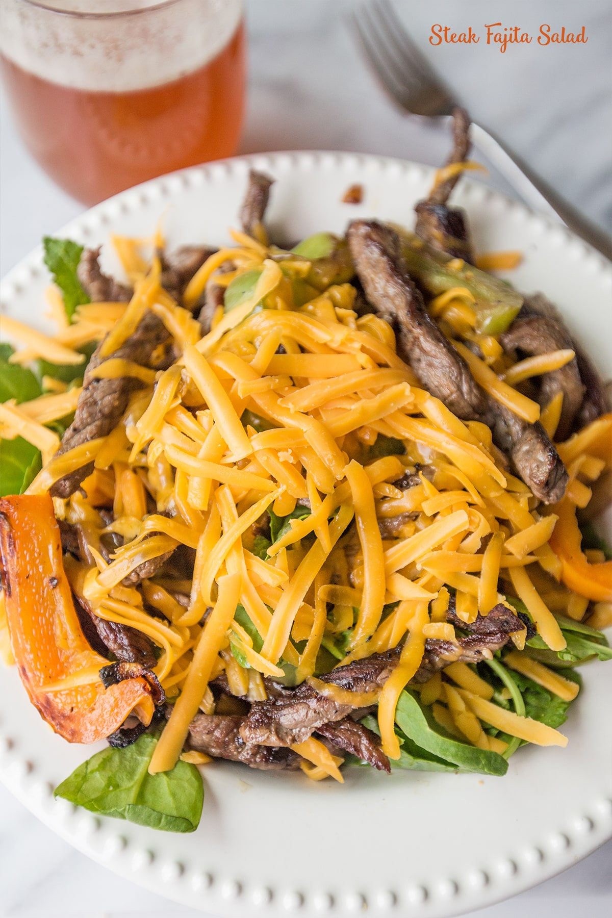 Steak Fajita Salad- a summer favorite with a secret trick for perfect fajitas!