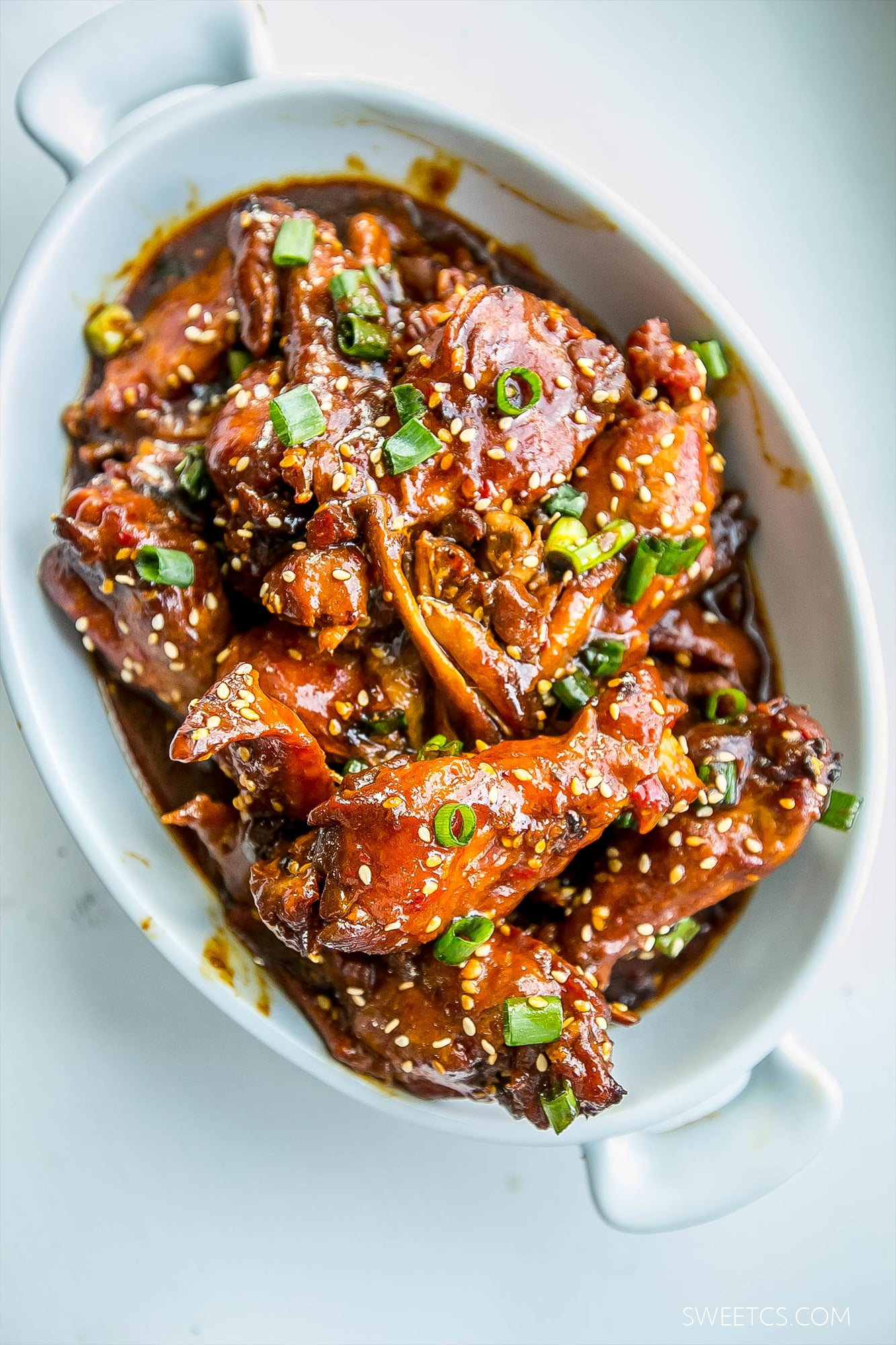 These are the most flavorful, fall off the bone wings- from a slow cooker! Honey soy give them a sweet and spicy twist!