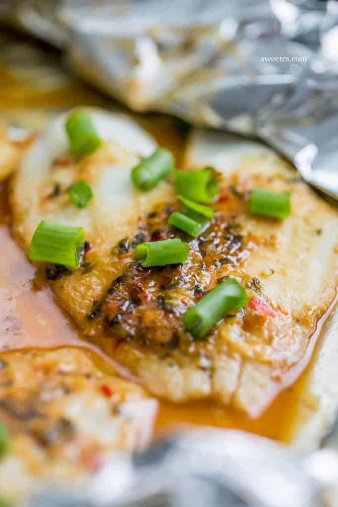 This is the most delicious and easy way to make asian inspired fish dishes with a spicy garlic soy glaze! Bakes right in a foil pouch for easy cleanup!