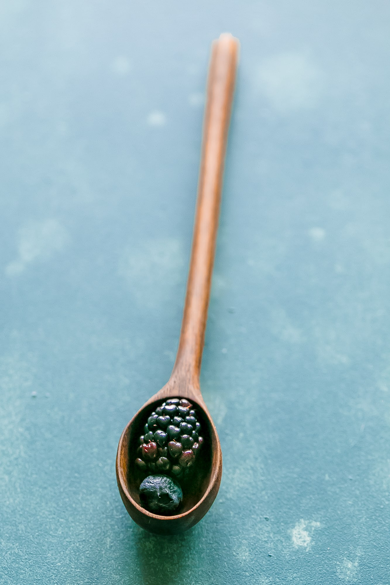 berries in a wood spoon