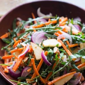 Apple Arugula Almond Salad with Orange Dressing is a healthy, spunky fall salad that takes minutes to put together and tastes delicious!