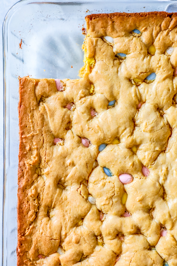 blondies, easter candy blondies, recipes with easter candy, cadbury mini egg recipes, baking with cadbury mini eggs, easter blondies recipe, cadbury mini eggs blondies recipe, leftover easter candy recipe, easter party dessert ideas, easy easter party snack, cooking with easter candy, the best blondies recipe,