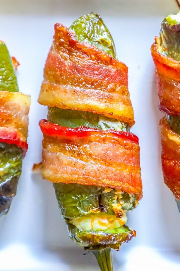 picture of bacon wrapped jalapeno poppers on a plate