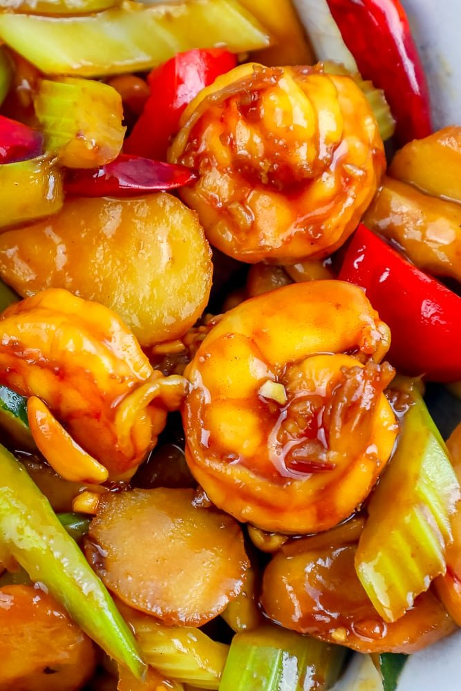 closeup picture of shrimp in kung pao sauce with vegetables