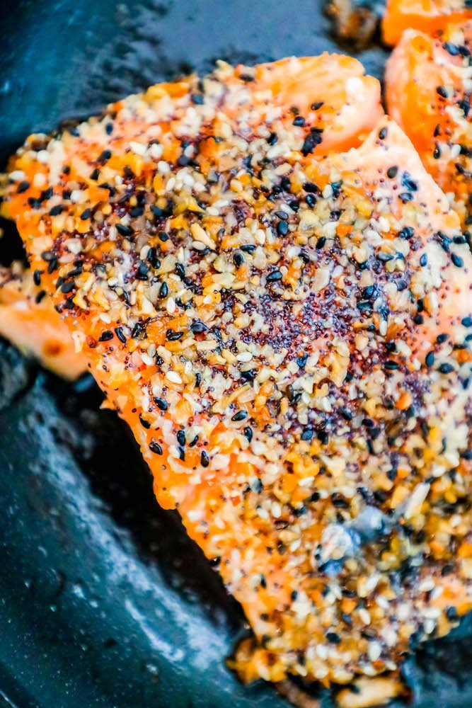 everything bagel seasoning encrusted salmon in a pan