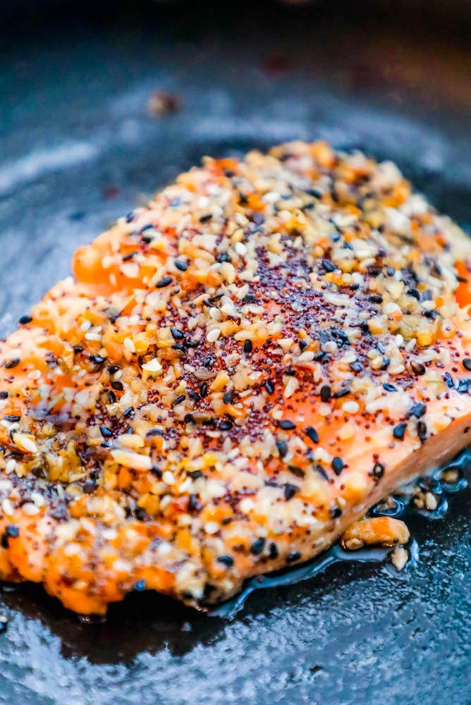 salmon in a pan baked with everything seasoning on top