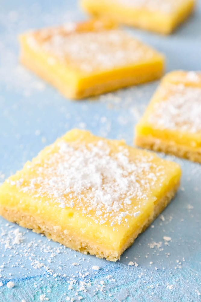 picture of lemon bars laying out on a table