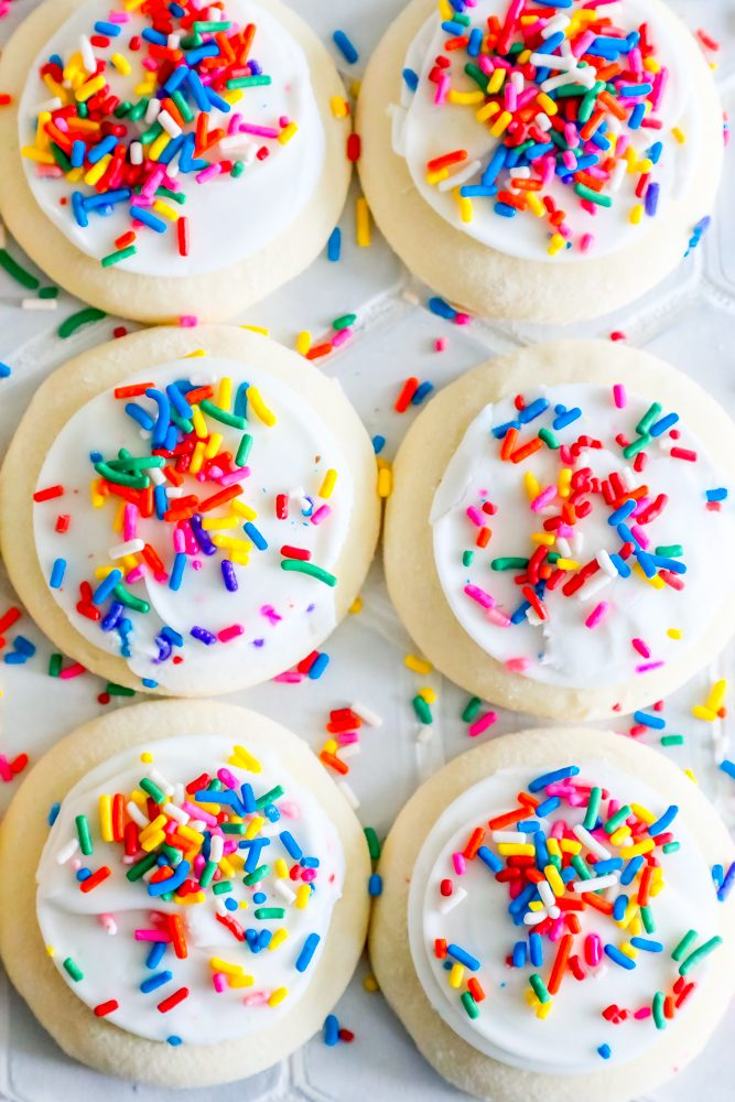 picture of four iced cookies with sprinkles