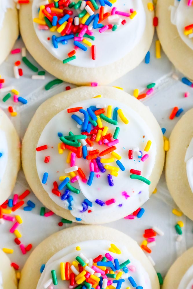 Closeup picture of sugar cookie with bright sprinkles on a table