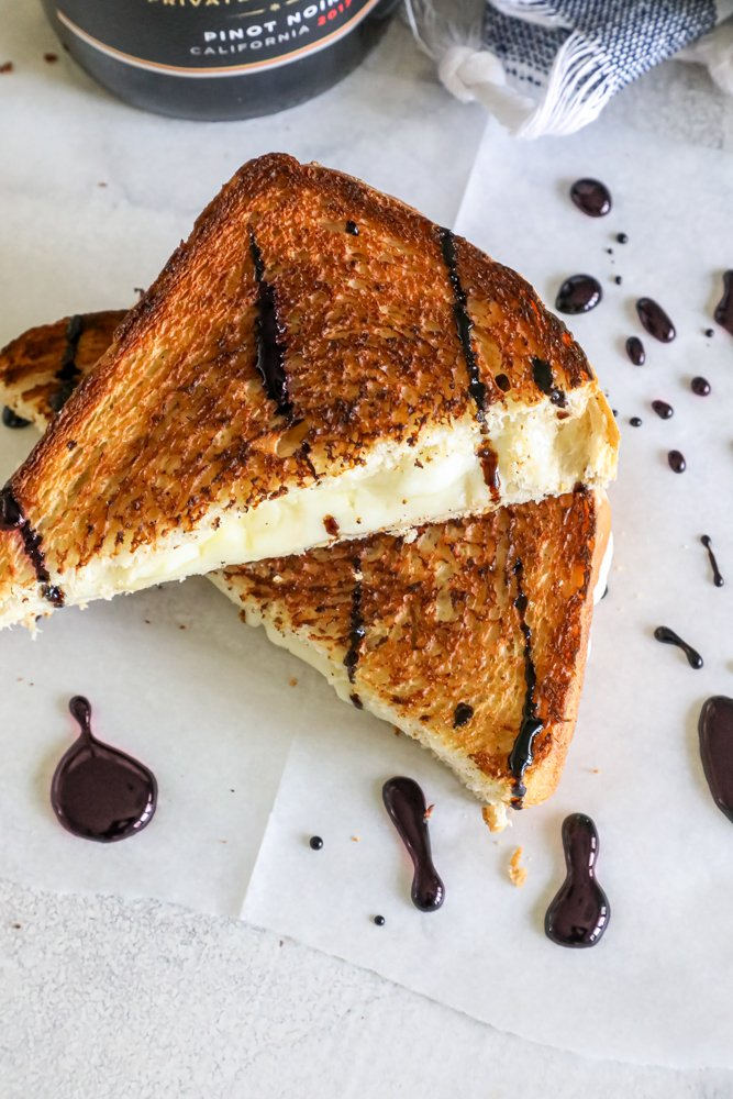 Picture of grilled cheese sandwich with wine sauce