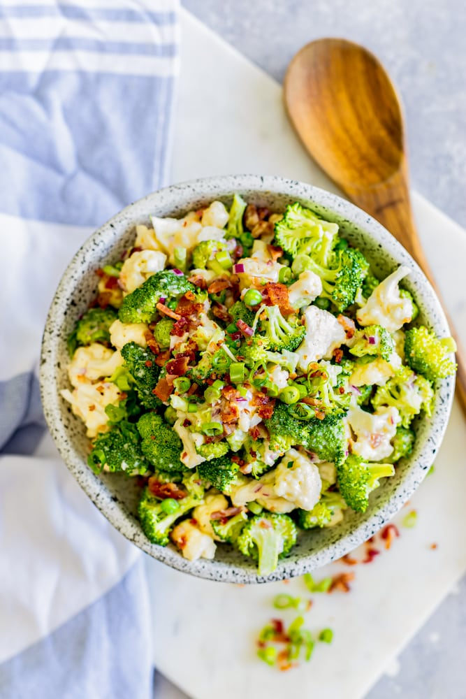 broccoli salad in a bowl tossed in creamy dressing