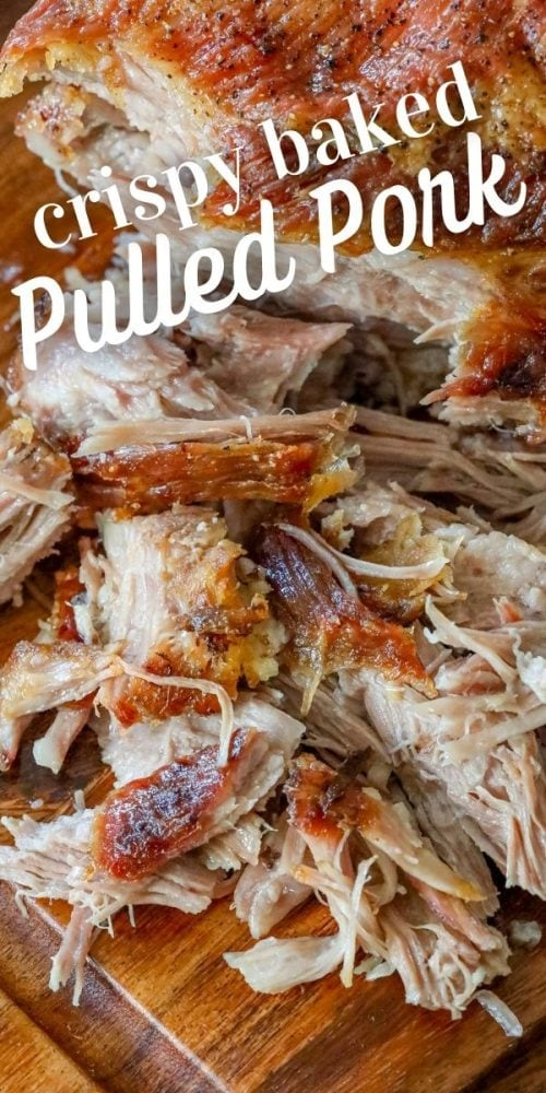 picture of pulled pork with crunchy skin shredded on a cutting board