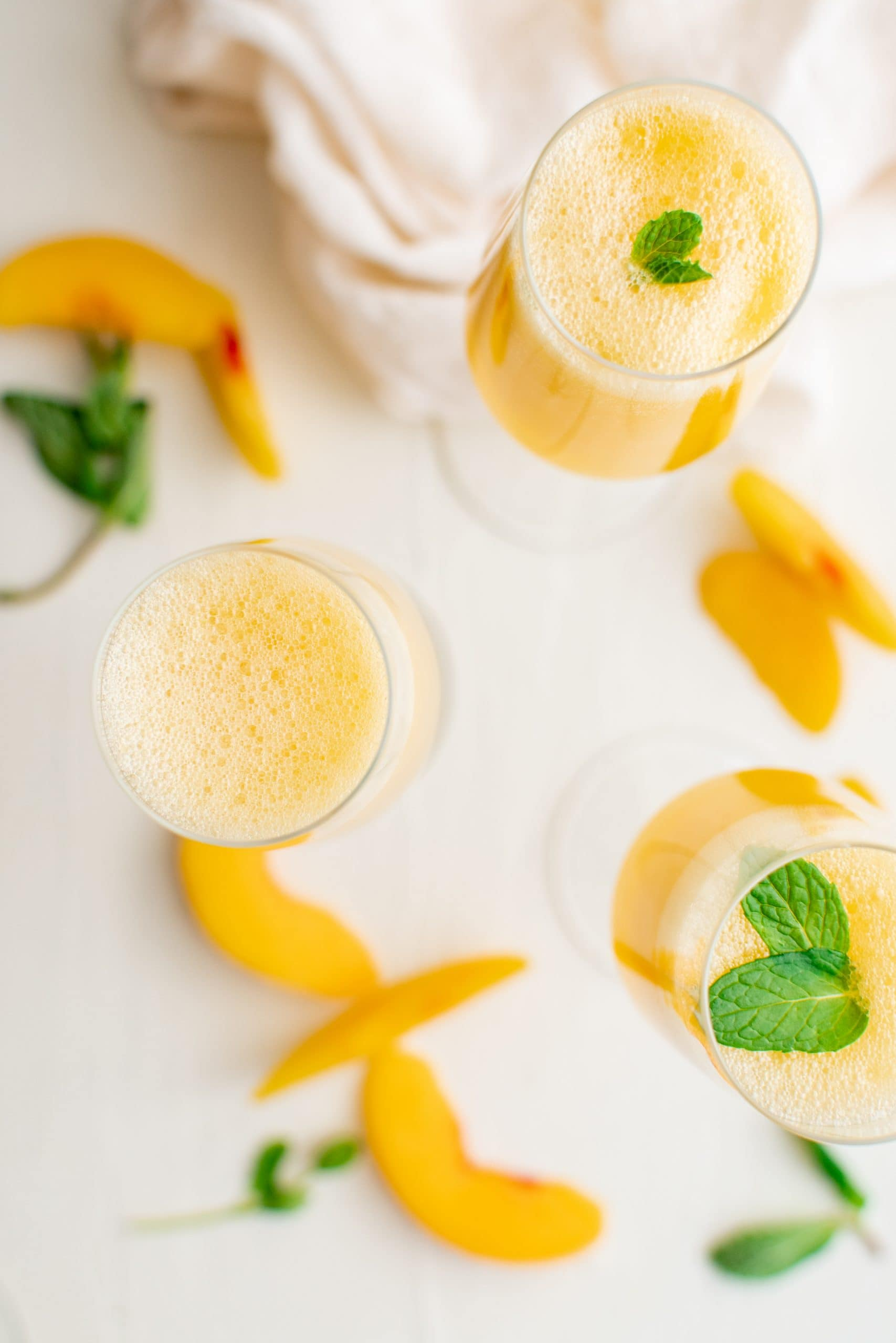 picture of peach bellinis in a champagne glass