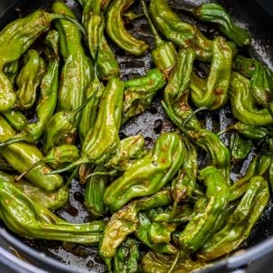 picture of shishito peppers in an air fryer basket