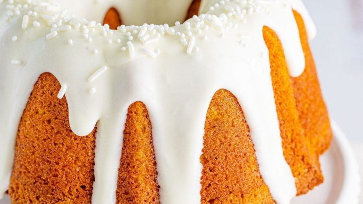 picture of air fryer pumpkin bundt cake on a white cake stand