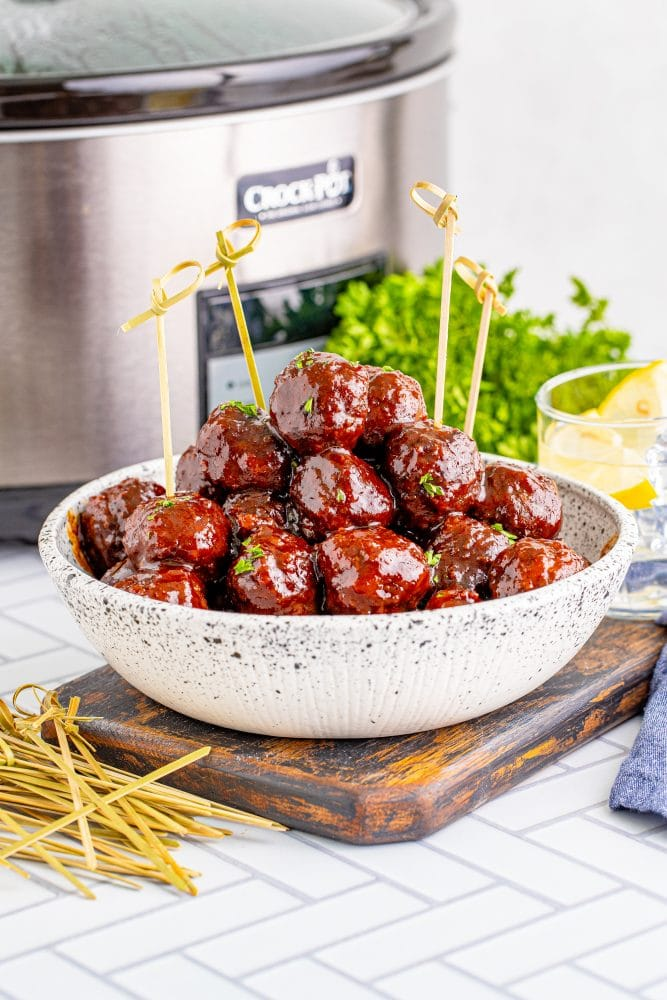 picture of grape jelly meatballs in front of a slow cooker